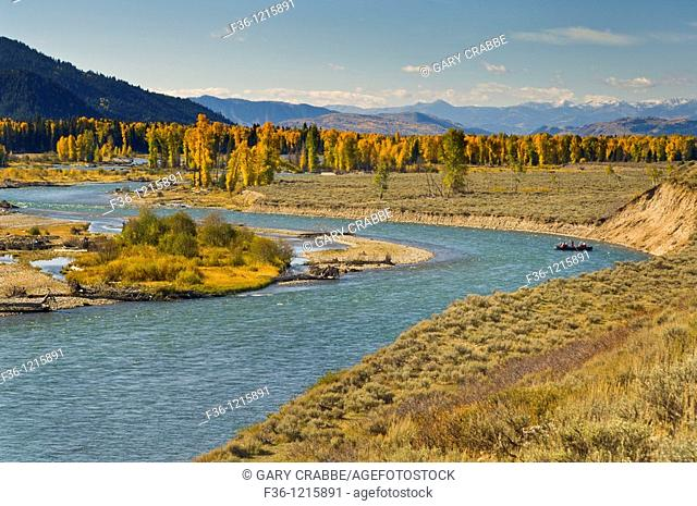 Tourists on float raft trip along the Snake River in fall, Grand Teton National Park, Wyoming
