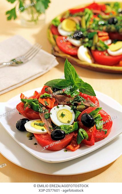 Anchovies and tomatoes salad