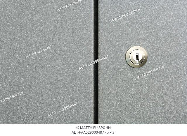 Lock on cabinet door, full frame