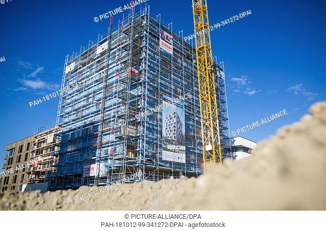 12 October 2018, Baden-Wuerttemberg, Heilbronn: Construction work being carried out on Germany's first wooden high-rise. The building is located on the grounds...