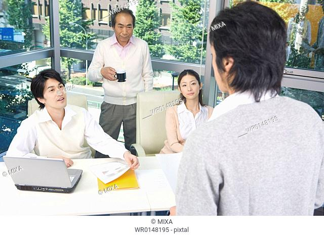 Four people working in office