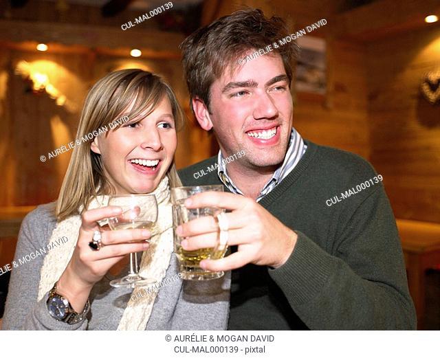 Couple having drinks in restaurant