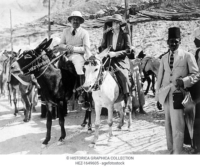 Visitors to the Tomb of Tutankhamun, Valley of the Kings, Egypt, 1922. Lady Ribblesdale and Mr Stephen Vlasto arriving on donkeys