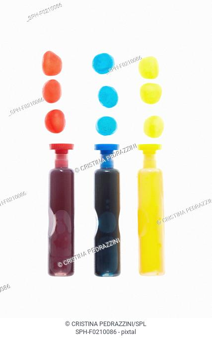 Three containers with coloured liquid spots