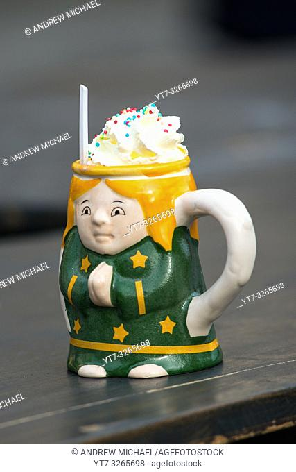 Punsch topped with whipped cream in ceramic mug at Christmas Market at Belvedere Palace, Vienna, Austria