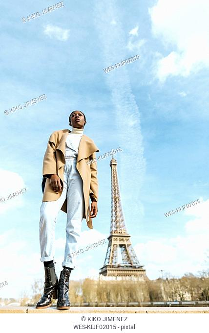 France, Paris, Woman posing with the Eiffel tower in the background