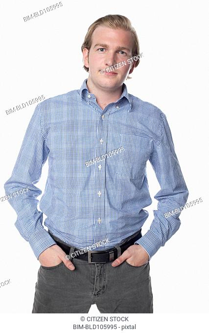 Serious Caucasian man with hands in pockets