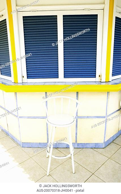 Chair in front of a closed store