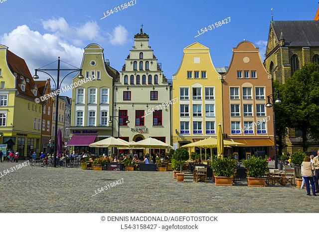 A popular cruise ship stop on the Baltic Sea Rostock is a city straddling the Warnow River on the north coast of Germany. Itâ