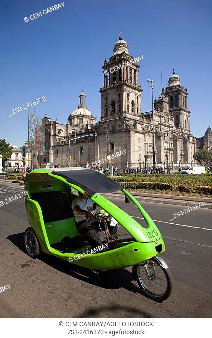 Metropolitan Cathedral on La Plaza de la Constitucion Square at the the city center with green bici-taxi in the foreground, El Zocalo, Mexico City, Mexico