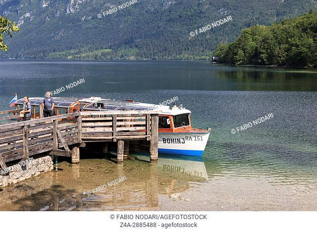 Tourists on a small boat in lake Bohinj, a famous destination not far from lake Bled