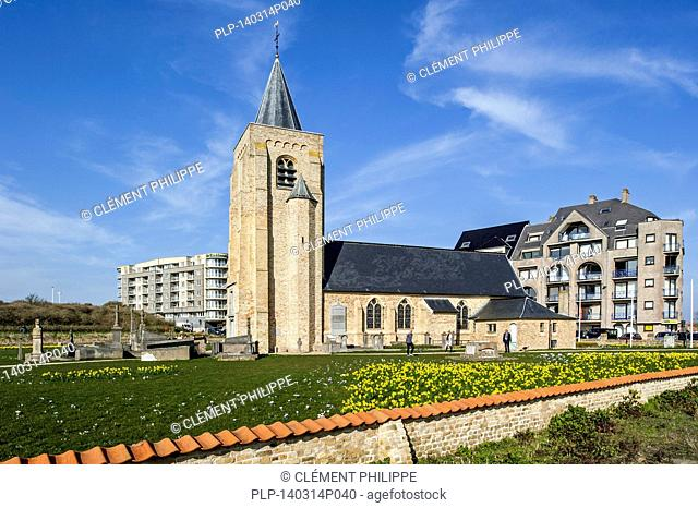 Apartments and the church Onze-Lieve-Vrouw-ter-Duinen / Our Lady of the Dunes at Mariakerke near Ostend, Belgium