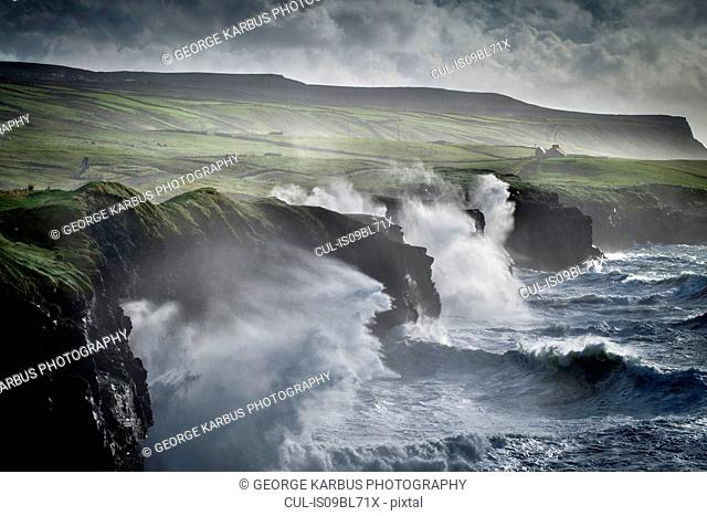 Waves crashing against the Cliffs of Moher, Doolin, Clare, Ireland
