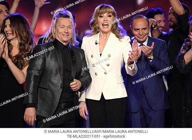 Hosts Paolo Belli, Milly Carlucci and journalist Bruno Vespa during the tv show Porta a porta, Rome, ITALY-21-02-2017
