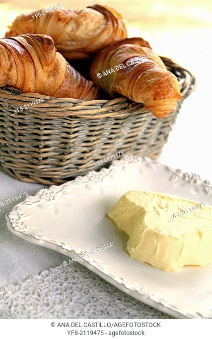 France, Provence country, Table ready for breakfast with croissants and butter