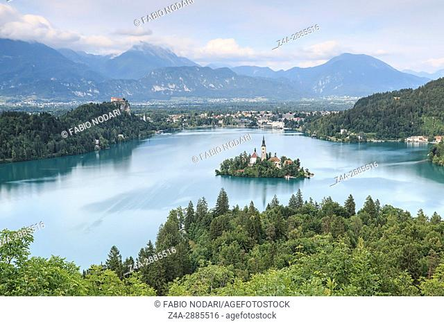 Aerial view of lake Bled at sunset with a view of the island church and the castle