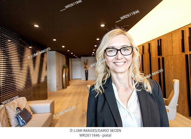 Portrait of businesswoman in lobby