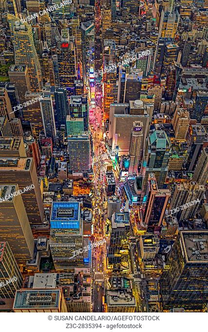 Aerial Times Square New York City - Aerial view at night to the iconic landmark of Times Square in 42nd Street in midtown Manhattan in NYC