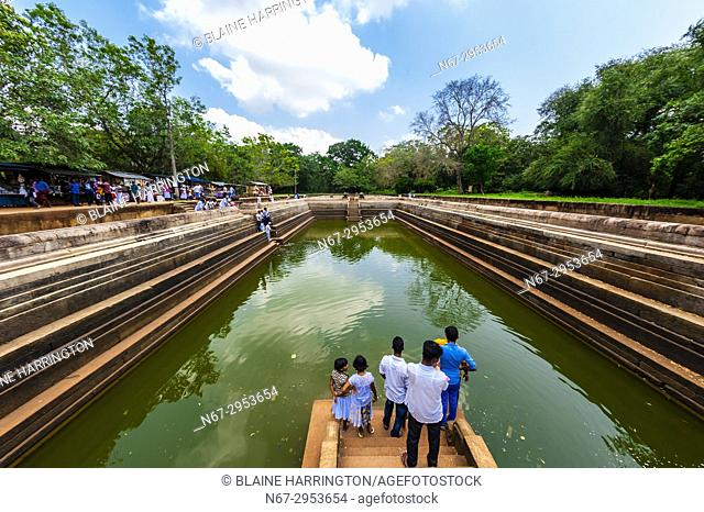 Water tank, Anuradhapura, Sri Lanka. Anuradhapura is one of the ancient capitals of Sri Lanka, famous for its well-preserved ruins of an ancient Sri Lankan...