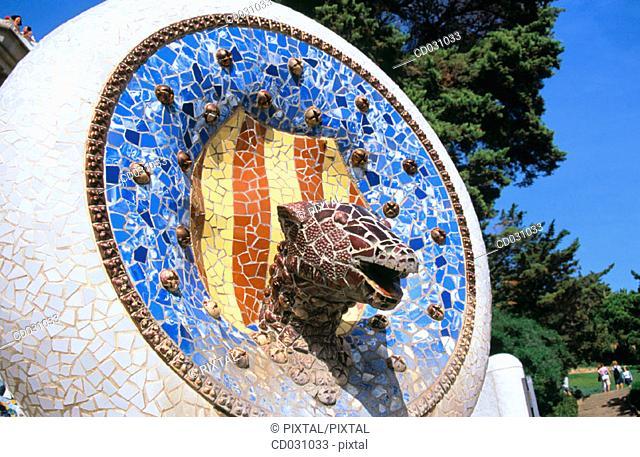 Decorative mosaic with Catalan elements at the Güell Park (Gaudí, 1900-1914). Barcelona. Spain