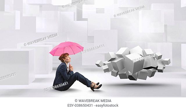 Woman sitting with umbrella next to geometric surreal cubes