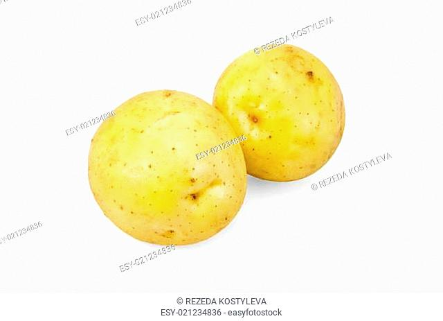 Two whole yellow potatoes isolated on white background