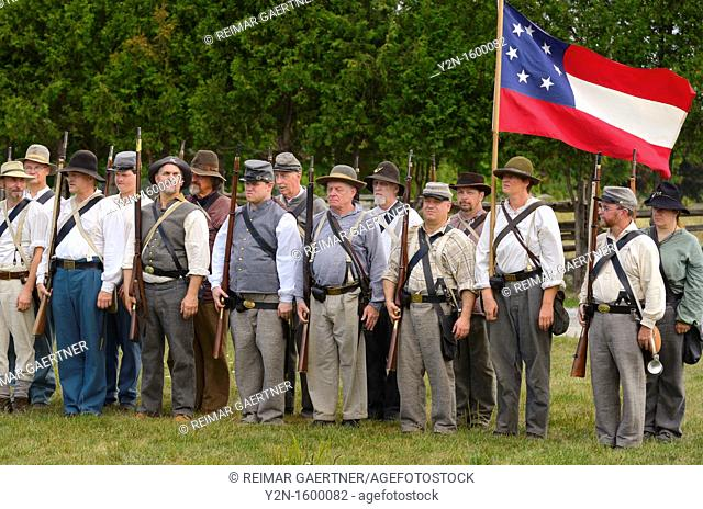 Company of conscripted Confederate soldiers at attention with first seven star National flag in Milton Ontario Canada reenactement