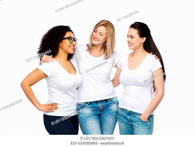 friendship, diverse, body positive, communication and people concept - group of happy different size women in white t-shirts hugging and talking