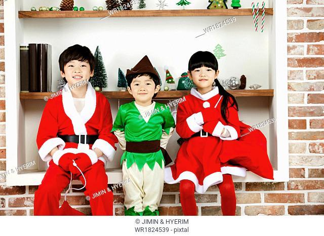 Three kids wearing costumes