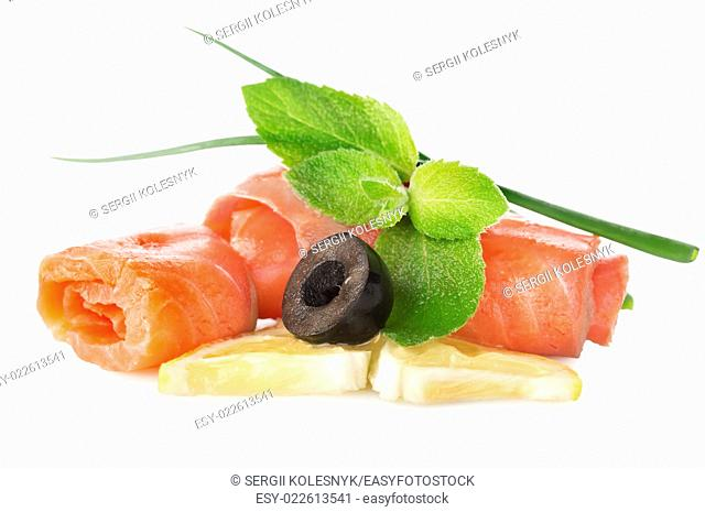 Fish with olives and lemon isolated on a white background