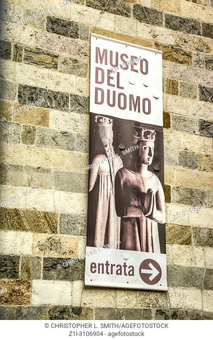 Advertising poster for the Museo Del Duomo on the wall of a building in Udine, Italy
