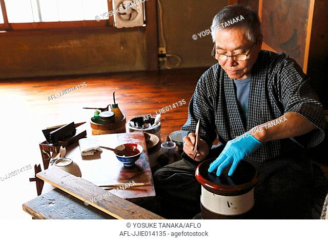Japanese lacquer artisan working in the studio