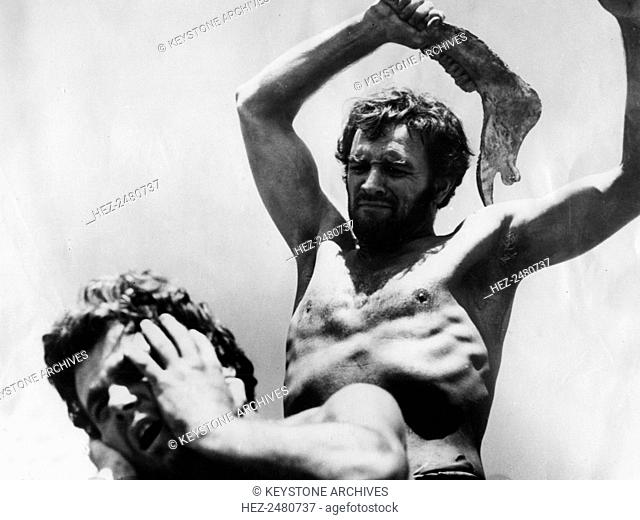 A scene from the film 'The Bible: In the Beginning', 1966. Cain, played by Richard Harris (1930-2002), killing Abel, played by Franco Nero (1941-)