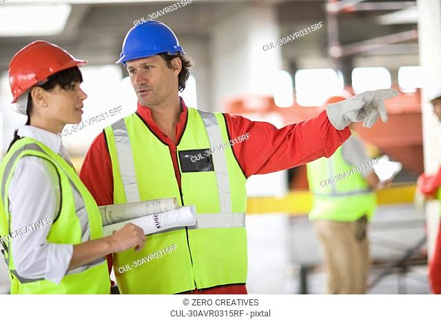 Architect talking to a builder