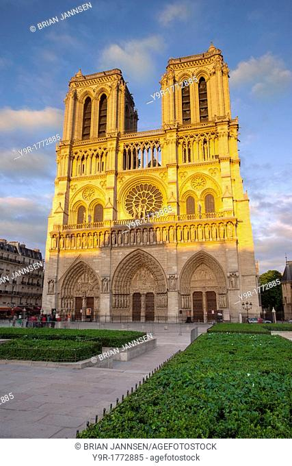 Setting sunlight glows on the facade of Cathedral Notre Dame, Paris France