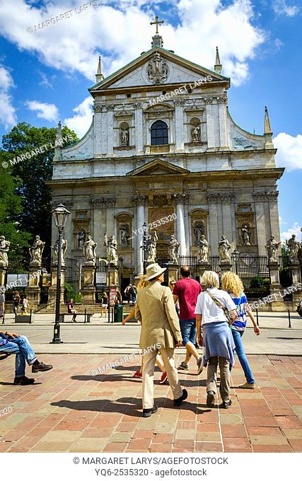 Tourists visiting historical places, St Peter and Paul Church in Krakow, Poland