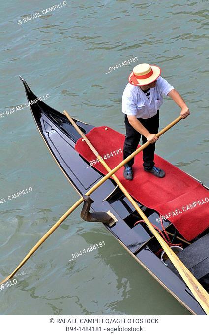 Gondola and gondolier in the Grand Canal, Venice, Veneto, Italy