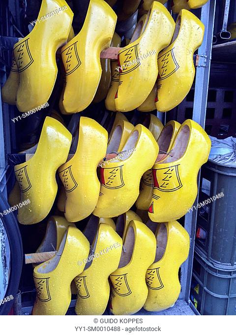 Blaak, Rotterdam. Original Dutch clogs on a rack during thursday market. This traditional footwear is still being sold. However, mainly tourists are buyers