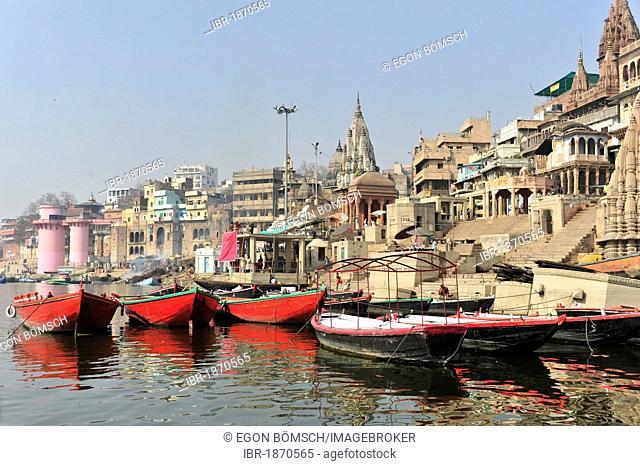 Boats and Ghats or steps on the Ganges River, Varanasi, Benares, Uttar Pradesh, India, South Asia