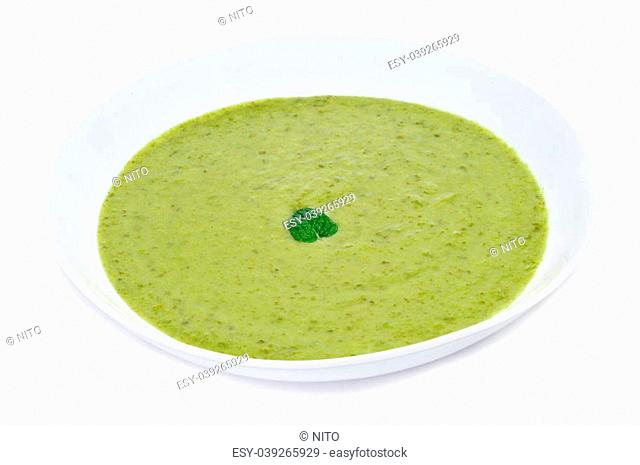a bowl with vegetables puree on a white background