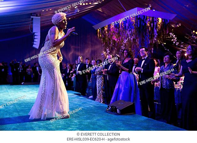Singer Mary J. Blige performs during the State Dinner for President Francois Hollande of France. Feb. 11, 2014. Michelle wears a Carolina Herrera gown