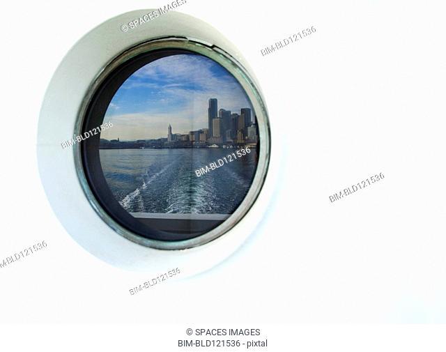 City skyline reflected in ferry porthole, Seattle, Washington, United States