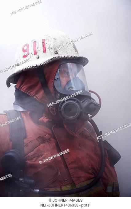fire fighter wearing oxygen mask