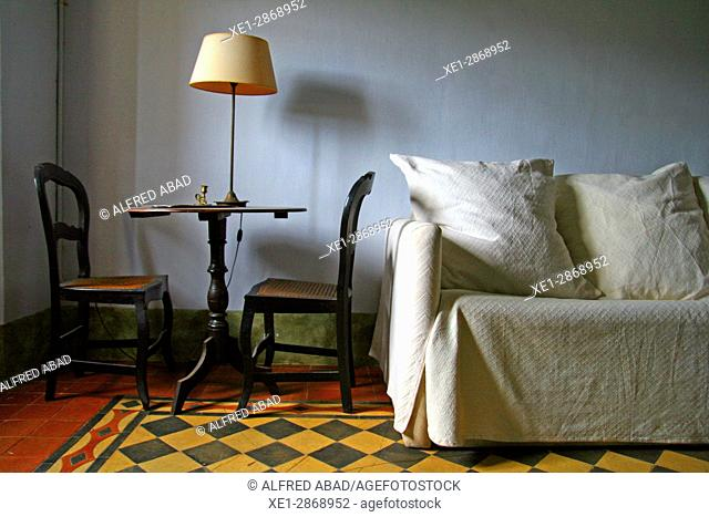 Chairs, bedside table and sofa, Mas Turro cottage, Les Gavarres, Baix Emporda, Catalonia, Spain