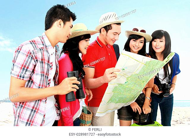 group of teenager going on vacation see on map