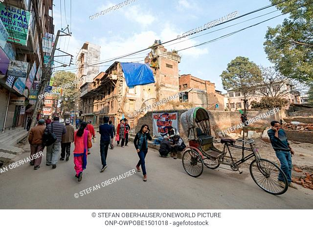 Nepal, Central Region, Kathmandu, street life with rickshaw and passersby in Thamel