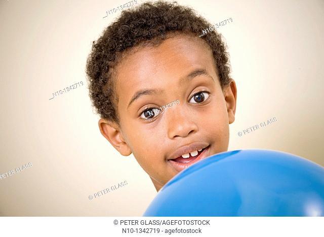 Young black boy holding a balloon