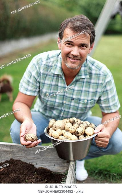 Man harvesting potatoes