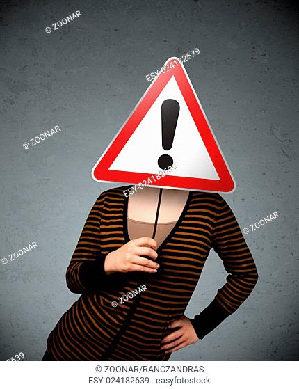 Young woman holding an exclamation road sign