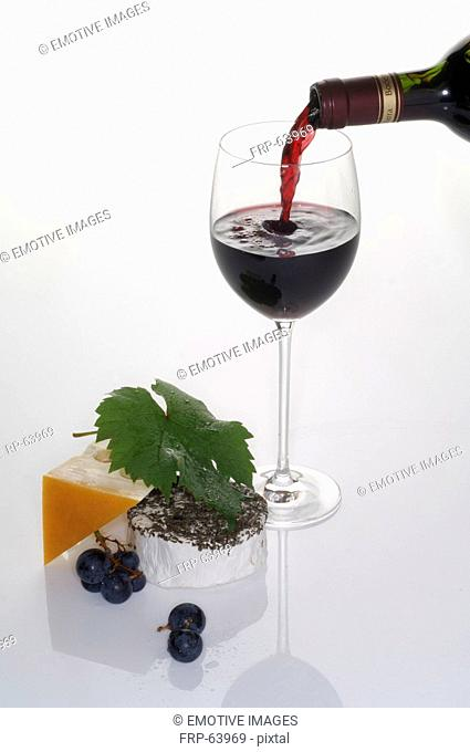 Pouring wine into a wine glass